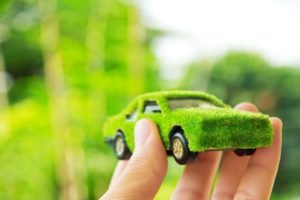 12602171 - hand holding eco car icon concept